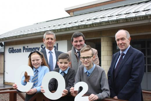 Pictured celebrating EA's Silver status in the 2018 Northern Ireland (NI) Environmental Benchmarking Survey are (Back Row, L-R) John Coney, EA Energy and Environment Officer; Jonathan Glendinning, EA Assistant Director Facilities Management; Robert McCreery, EA Energy and Environment Officer and (Front Row L – R) pupils from Gibson Primary School in Omagh.